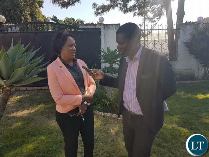 Action Aid Country Director Nalucha Ziba being interviewed during the news briefing.