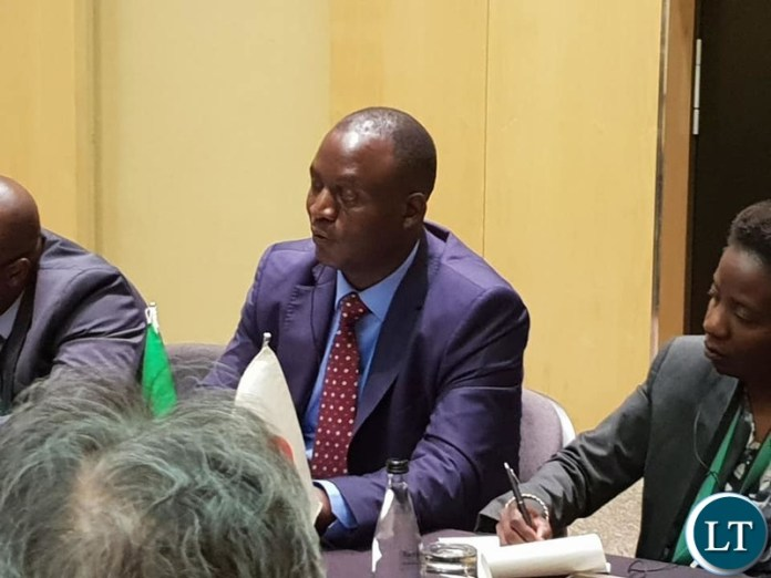 Mines Minister Richard Musukwa at the meeting with the Japanese Officials