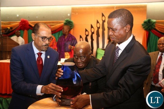 First Republican President Dr.Kenneth Kaunda being conferred with the 2018 Leadership award by UNAIDS Executive Director Mr.Michel Sidibe and President Edgar Lungu in Lusaka