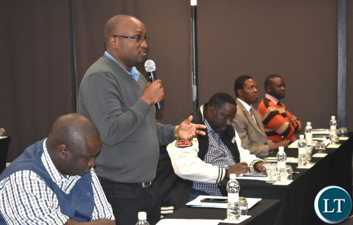 Ministry of National Development Planning (Director – Monitoring and Evaluation) Dr. Richard Banda (left) speaking at the national consultative stakeholders meeting on setting up the National Climate Change Fund (NCCF) in Livingstone on Monday 18 June 2018. On his left (Director – Development Planning) Mr. Mulele Mulele and Permanent Secretary (Development Planning and Administration) Mr. Chola Chabala. PHOTO | CHIBAULA D. SILWAMBA | MNDP