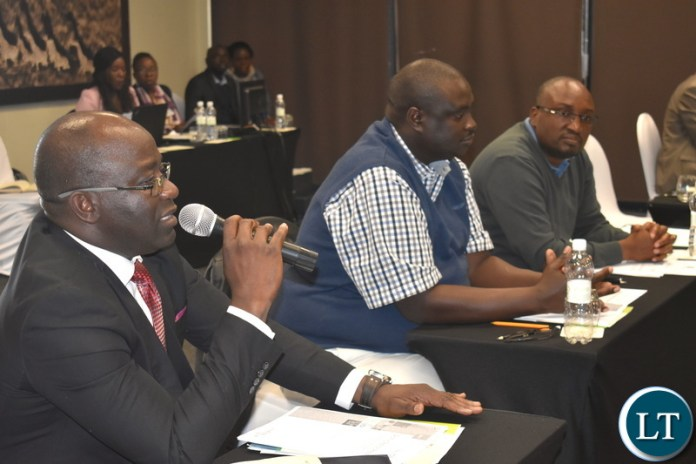 Dr. Richard Banda, MNDP Director - Monistoring and Evaluation, Mr. Mulele Mulele and PS Chola Chabala at National Designated Authority - National Consultative Stakeholders meeting on Nat. Climate Change Fund