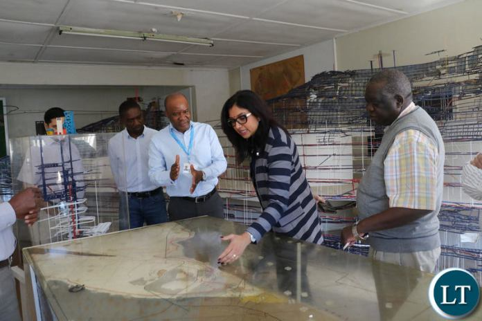 Vedanta's Africa Base Metals CEO Deshnee Naidoo with the KCM team during her familiarization tour of Konkola underground facilities recently.