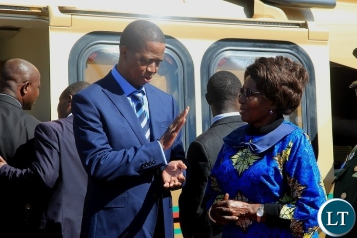 President Edgar Lungu confers with Vice President Inonge Wina before departure for Kenya for a private visit at Kenneth Kaunda International Airport