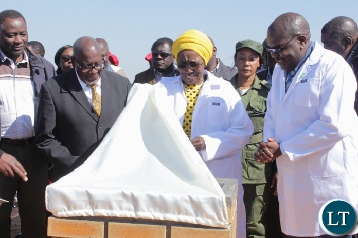 Vice President Inonge Wina (c) unveils the Foundation Lay Stone as Health Minister Chitalu Chilufya (r), Barotse Royal Establishment (BRE) Ngambela (Prime Minister) Mwenda Nyambe (l) and Western Province Minister Richard Kapita (far left) look on during the ground breaking ceremony for the proposed construction site of Lealui Mini Hospital in Mongu
