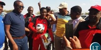 Kitwe United striker Emmanuel Chabula standing with club patron and Kitwe Mayor Christopher Kangombe.
