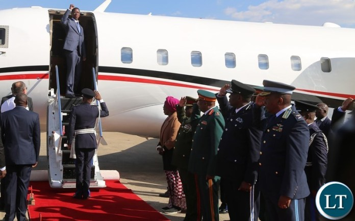 President Edgar Lungu wave the party symbol shortly before his departure for South Africa at Kenneth Kaunda International Airport