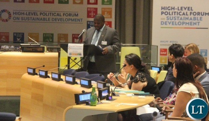 """Minister of National Development Planning, Honourable Alexander Chiteme addressing Member States at the ongoing United Nations (UN) High Level Political Forum (HLPF) on Sustainable Development themed: """"Transformation towards sustainable and resilient societies."""" Picture courtesy of Zambia Mission/WALLEN SIMWAKA"""
