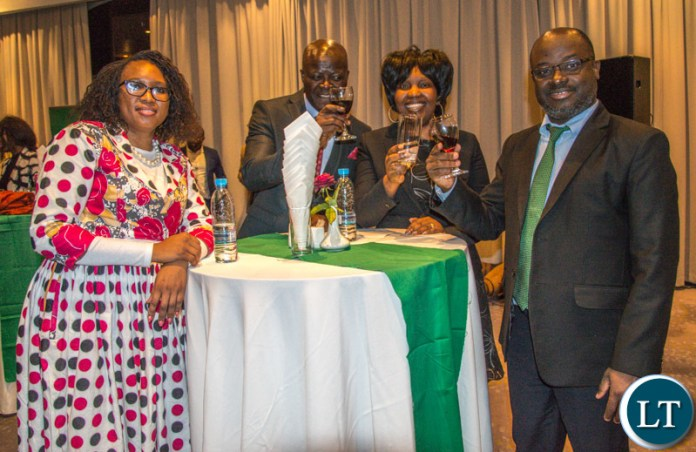 Zamtel CEO Sydney Mupeta (L) toasts with ZANAMACA President Frank Kameya, NATSAVE CEO Mukwandi Chibesakundawi and ZSIC Life CEO Christabel Banda during a cocktail party at Intercontinetal Hotel, Lusaka