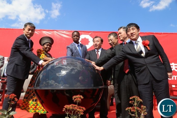 President Edgar Lungu with Chieftaniss Nkomeshya Mukamambo II starting off the crystal ball after the official opening of the China National Building Material Zambia Industry Plant in Chongwe District