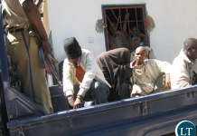 The two Kapiri gay men being taken away after making court appearance
