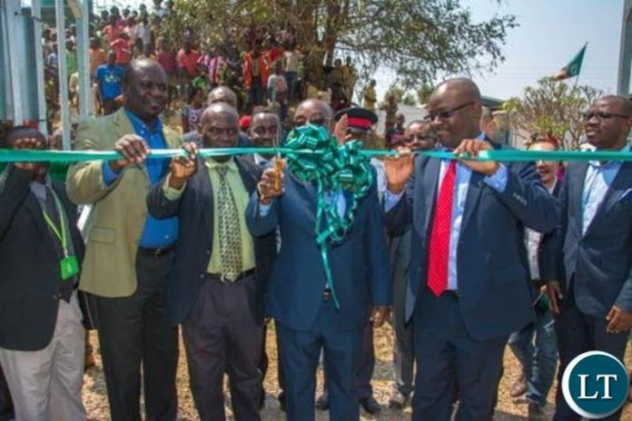 Transport and Communications Minister Brian Mushimba and ZAMTEL CEO Sydney Mupeta cutting the ribbon during the launch of a new communication tower at Kalilo in Chingola rural