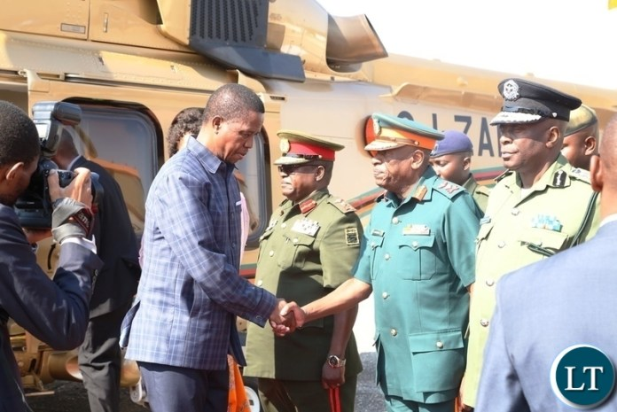President Edgar Lungu greets ZNS commandant Lt.Gen.Nathan Mulenga whilst other Service Chiefs looks on shortly before his departure to Livingstone at Lusaka City Airport
