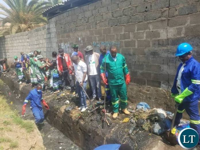 Lusaka Mayor, Miles Sampa helping with works in Lusaka