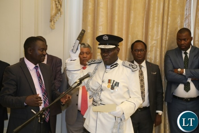 Newly appointed Southern Province Police Commissioner Diamond Likashi taking oath before President Edgar Lungu during swearing in ceremony at State House