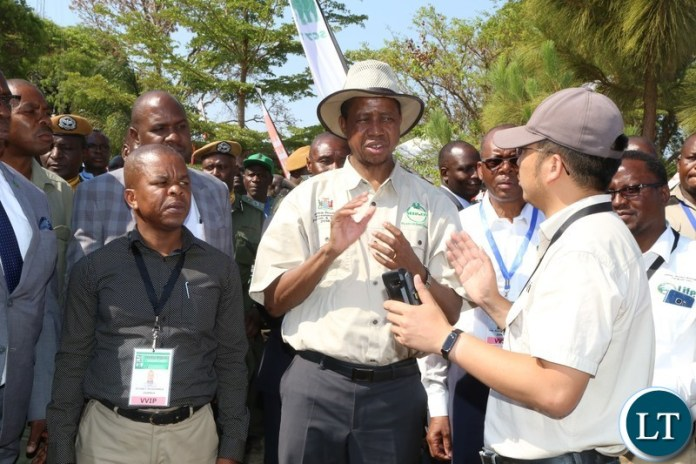President Edgar Lungu talks to Sunagri Techno-Farming Director Mr Fraser  during the tour of stands before the official opening of the Central Province Investment Forum and Expo in Kapiri District