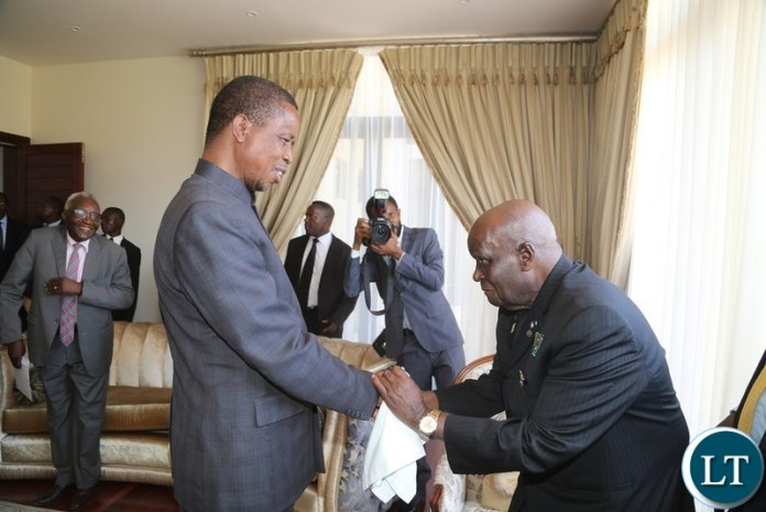 President Edgar Lungu greets the First Republican President Dr. Kenneth Kaunda during the handover ceremony of the House to the 4th Republican President Rupiah Banda at Bonaventure