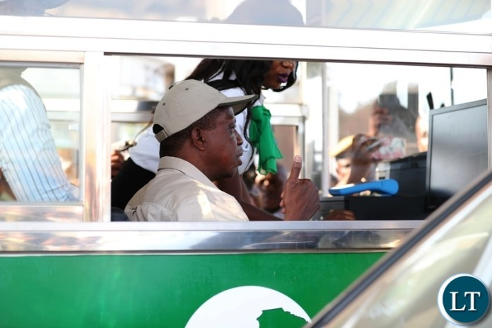President Edgar Lungu serving a motorist at the newly commissioned Michael Chilufya Toll Plaza on Sunday, 4th November, 2018, Picture by Eddie Mwanaleza.