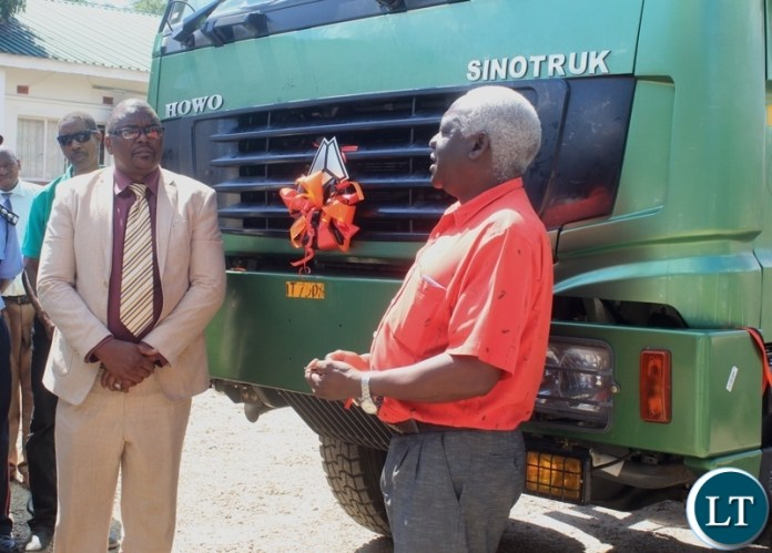 Mongu Mayor Akayombokwa Kusiyo (r) interacts with Western Province Deputy Permanent Secretary Bernard Chomba (l) shortly after handing over a truck to Mongu Municipal Council for garbage collection at a total cost of k784, 200.80 in Mongu, Western Province.
