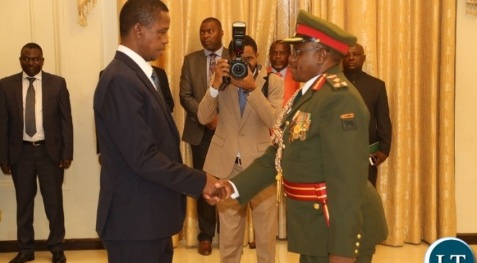President Edgar Lungu congratulates the Newly appointed Zambia Army Commander Lt. Gen. William Sikazye shortly after taking Oath before President Edgar Lungu at State House