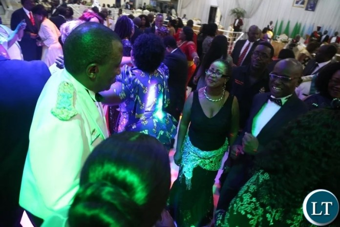 Zambia Air Force Commandant Lt. Gen David Muma and Special Assistant to the President for Press and Public Relations Amos Chanda (r) join the floor during the Zambia Air Force Annual Ball open floor at Chamba Valley Banquet Hall
