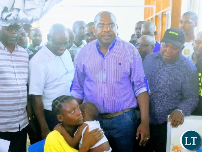 Minister of Health Chitalu Chilufya who was accompanied by Presidential Affairs Minister Freedom Sikazwe and Chipata Central Member of Parliament Moses Mawere and the the boy's mother, 19 year old Rosemary Jere