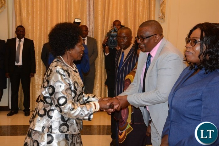 Vice President Inonge Wina congratulates the Newly Appointed Permanent Secretary Central Province Bernard Chomba during swearing in ceremony at State House