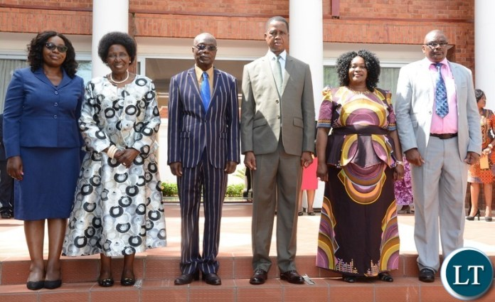 President Edgar Lungu and Vice President Inonge Wina (2nl) the Newly Appointed Permanent Secretaries, Newly Appointed Permanent Secretary Ministry of Health Kakulubelwe Caroline (l),Newly Appointed Permanent Secretary North Western Willies Mangimela (third from Left) Newly Appointed Permanent Secretary Central Province Bernard Chomba (r) and Newly Appointed Permanent Secretary Muchinga Province Joyce Nsamba (2nr) take official photo shortly after Swearing in Ceremony at State House