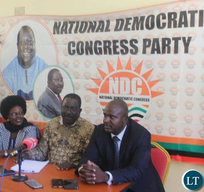 NDC Vice President Mr Joseph Akafumba (c) addressing a media briefing