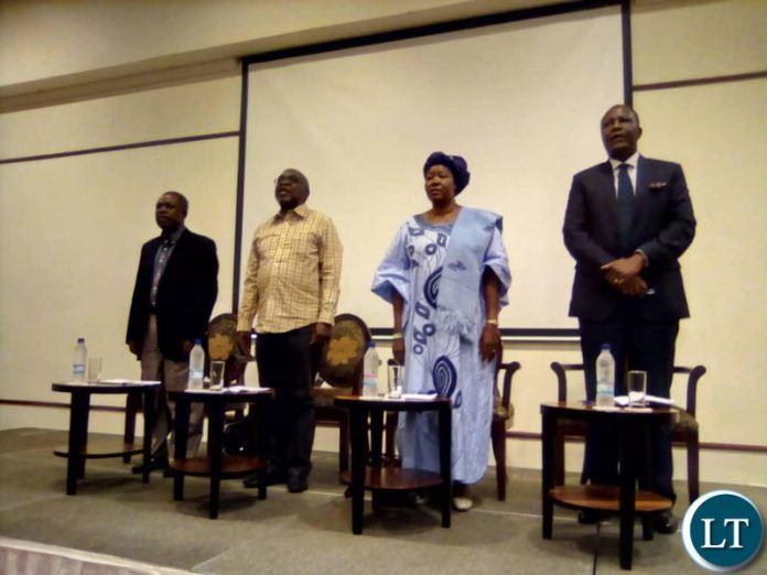 MMD faction President Felix Mutati, FDD President Edith Nawakwi, ULP President Sakwiba Sikota and Raimbow Party leader Wynter Kabimba sign the national anthem at the start of a press briefing at Pamodzi Hotel.