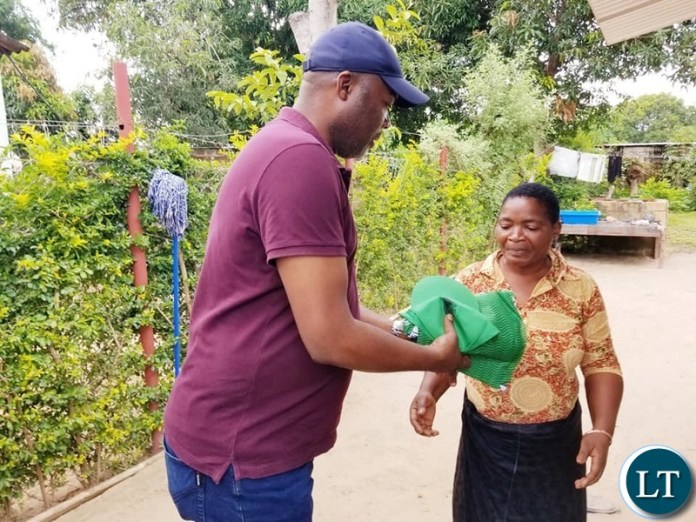 Kabushi Member of Parliament Bowman Lusambo on a Door to Door Campaign in Luanshya distributing campaign materials to voters