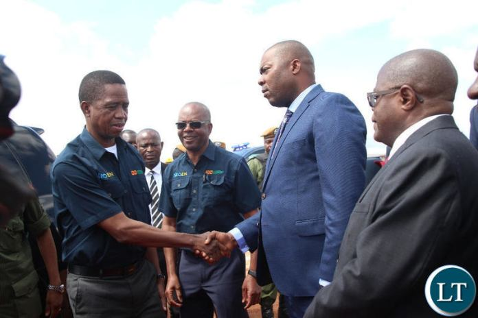 President Edgar Lungu greats Lusaka Province Minister Bowman Lusambo at the commissioning ceremony