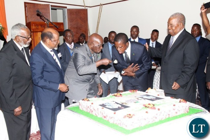 Zambia 1st President Kenneth Kaunda feeding Zambia 6th President Edgar Chagwa Lungu while looking on are Nambia former president Sam Nujoma  and Mozambique former president Joaquim Chisano and Zambia 4th President Rupiah Bwezani during the 95th birthday celebrations of KK at Lusaka Taj Pamodzi Hotel.