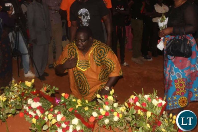 NDC Leader Chishimba Kambwili on the grave of Mr Kasongo at Memorial Park on Saturday evening