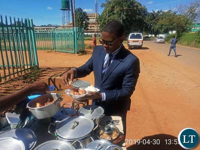 Chilufya Tayali captured buying Nshima from a street vendor in Lusaka