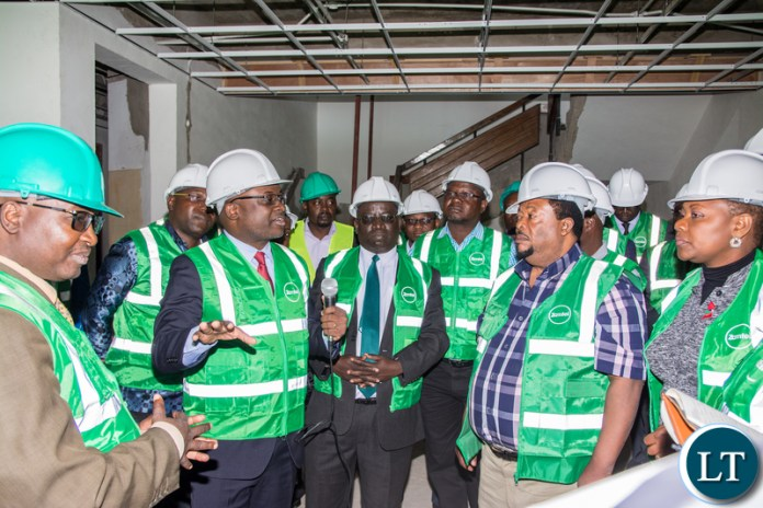 Zamtel CEO Mr Sydney Mupeta briefs Members of the Parliamentary Committee on Parastatals over the ongoing refurbishment of Lamya House during their tour of Zamtel facilities on Monday, June 3rd 2019.