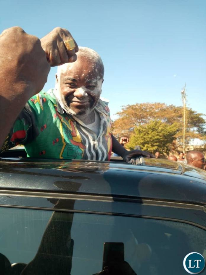 Mr Chitotela waves to his supporters after he was acquitted
