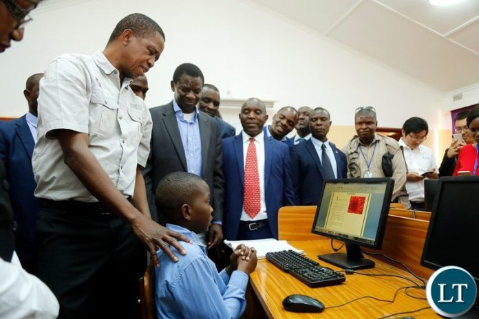 President Edgar Chagwa Lungu (left) talks to 13 year old Mutande Kalileka during the commissioning of Chati South Boarding Secondary School in Kalulushi on Sunday,July 7,2019. PICTURE BY SALIM HENRY/STATE HOUSE ©2019