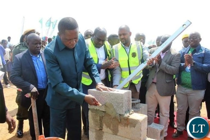 Republican President of Zambia, His Excellency Dr. Edgar Chagwa Lungu laying the foundation stone for construction of the landmark 800 bed capacity ultra morden state of the art Bangweulu Regional Hospital.  The President is flanked by Health Minister of the Republic of Zambia, Hon. Dr. Chitalu Chilufya, Housing and Infrastructure Minister, Hon. Vincent Mwale, Northern Province Minister Hon. Lazarus Chungu and Kasama Central Lawmaker Hon. Kelvin Sampa.  Photo Credit : Ministry of Health