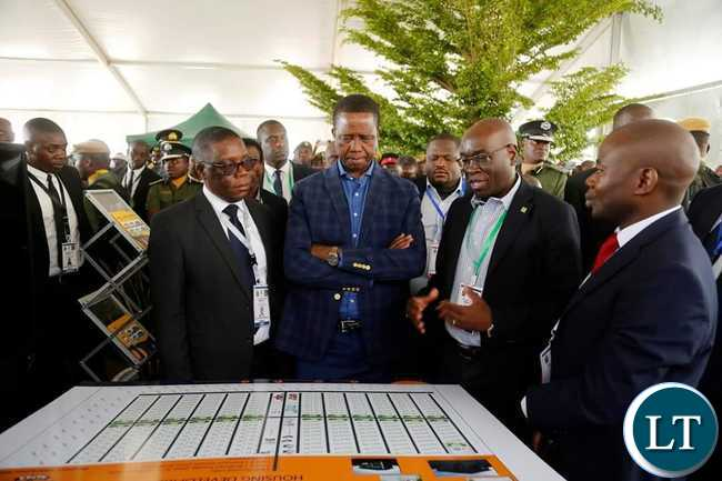 President Edgar Chagwa Lungu (centre) listens to NAPSA Director General Yollard Kachinda (second from right) as he explains on the Solwezi 400 Housing Units which the company will construct. This was at Solwezi City Hall during the North West Expo on Monday, August 19,2019. PICTURE BY SALIM HENRY/STATE HOUSE ©2019