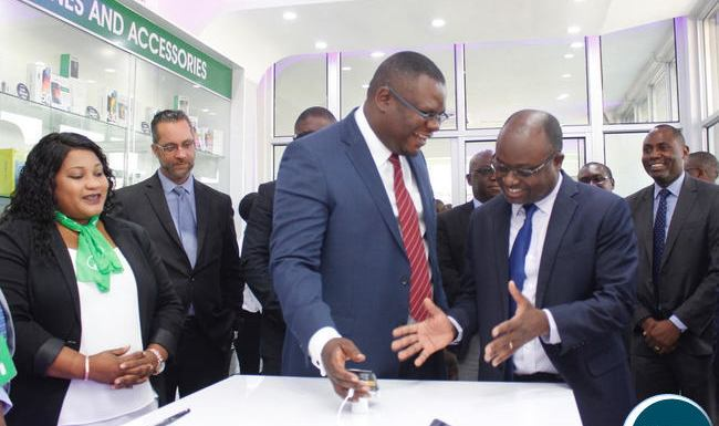 IDC Group CEO Mateyo Kaluba chats with Zamtel CEO Sydney Mupeta during the launch of the Woodlands Customer Service Centre