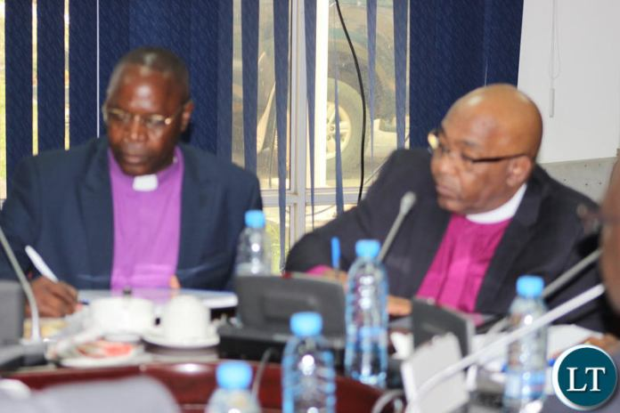 Members of the clergy representing the Evangelical Fellowship of Zambia making submissions to the parliamentary committee.