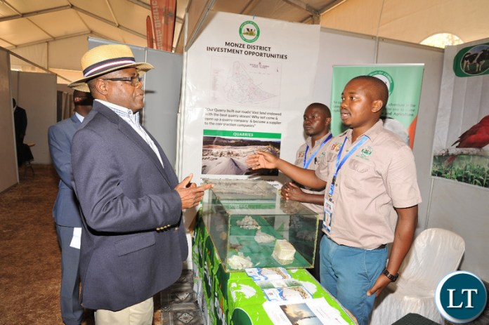 MTC Socio-Economic Planner Jack Deka explaining the Bweengwa Industrial Park concept to Commerce Minister Christopher Yaluma