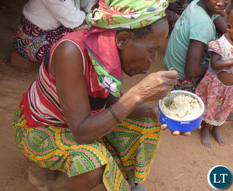 Villagers in Pemba eating Maize bran
