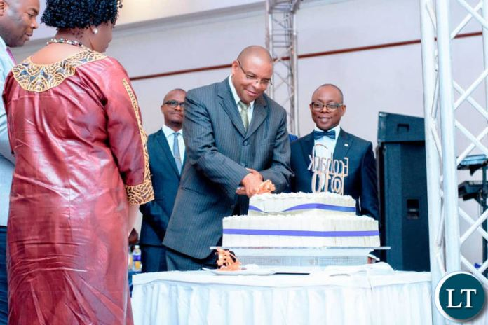 Bank of Zambia Governor Dr Denny Kalyalya cuts the cake during the 10th anniversary dinner for Ecobank Zambia dinner