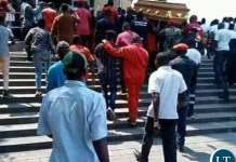 UPND cadres taking the coffin of the deseased after parading it in the Streats of Lusaka