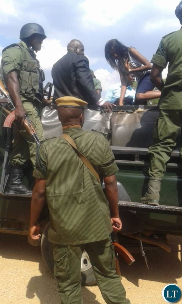 UPPZ leader Charles Chanda and daughter Esther being taken away by police