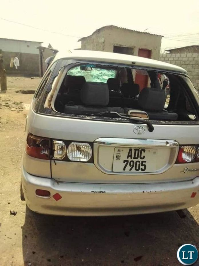 Vehicles damaged at the funeral home for late Lawrence Banda in Kanyama