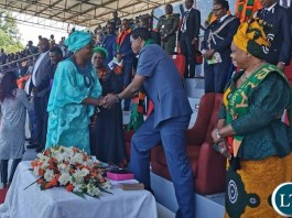 President EDGAR LUNGU shakes hands with leader of the opposition party FDD Edith Nawakwi at the prayer service in Lusaka