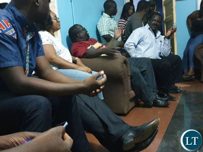 Chishimba Kambwili and NDC officials in the office of the Officer in Charge at Kitwe Central Police Station