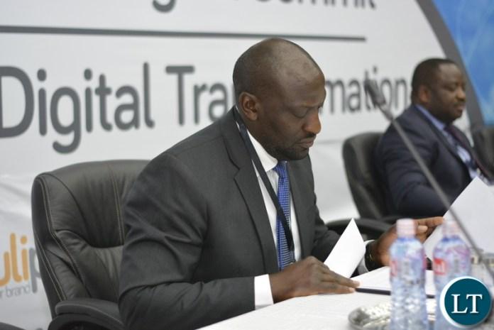 Patrick Mutimushi, Director General ZICTA (reading through his speech before address)